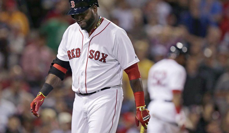 Boston Red Sox designated hitter David Ortiz heads to the dugout after striking out with two on during the ninth inning of a baseball game against the Los Angeles Angels at Fenway Park in Boston, Monday, Aug. 18, 2014.  The Angels defeated the Red Sox 4-2. (AP Photo/Charles Krupa)