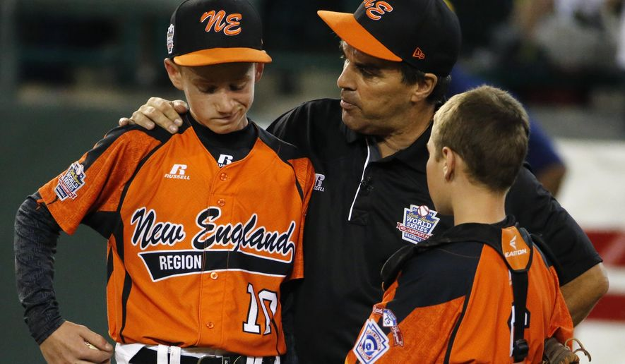 Cumberland manager David Belisle, center, talks with pitcher CJ Davock, left, and catcher Trey Bourque during the fifth inning of an elimination baseball game against Chicago at the Little League World Series tournament in South Williamsport, Pa., Monday, Aug. 18, 2014. Chicago won 8-7. (AP Photo/Gene J. Puskar)