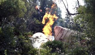 In this photo provided by the Lawrence County Sheriff, wreckage burns at the site of a railroad collision in Hoxie, Ark. on Sunday, Aug. 17, 2014. Arkansas State Police said two Union Pacific train crew members were killed and two others injured in the early morning accident. It's at least the second head-on collision involving the company's trains since 2012, when two collided in the Oklahoma Panhandle that June, which killed three crew members and injured a fourth. (AP Photo/Lawrence County Sheriff via The Jonesboro Sun)