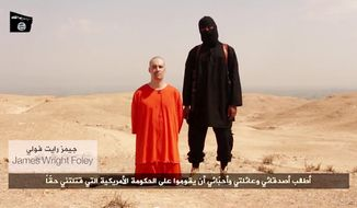 ** FILE ** A video posted by Islamic State terrorists showed the beheading of American photojournalist James Foley. Image via Youtube
