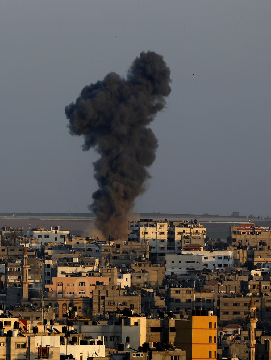 Smoke rises after an Israeli strike hit Gaza City in the northern Gaza Strip, Tuesday, Aug. 19, 2014. The Israeli military said it carried out a series of airstrikes Tuesday across the Gaza Strip in response to renewed rocket fire, a burst of violence that broke a temporary cease-fire and endangered negotiations in Egypt over ending the month long war between Israel and Hamas. The fighting occurred some eight hours before a temporary truce was set to expire. (AP Photo/Adel Hana)