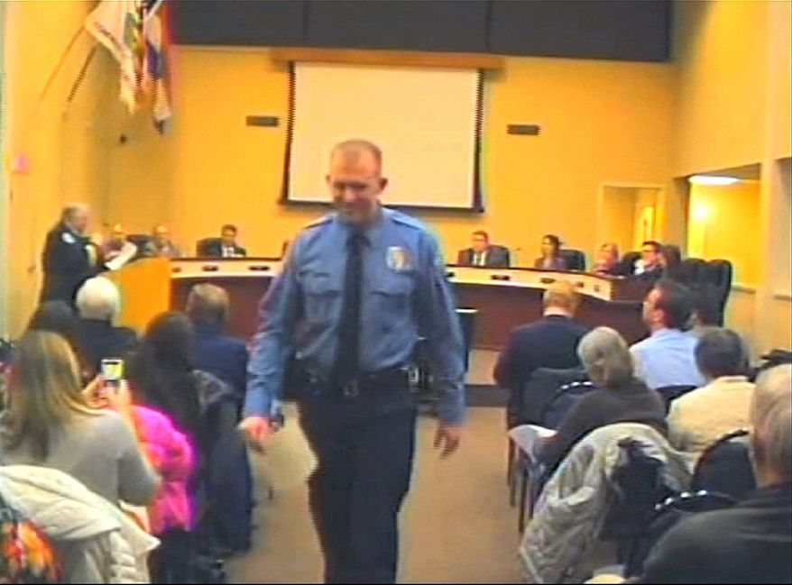 In this  Feb. 11, 2014 image from video released by the City of Ferguson, Mo., officer Darren Wilson attends a city council meeting in Ferguson.  Police identified Wilson, 28,  as the police officer who shot Michael Brown on Aug. 9, 2014, sparking over a week of protests in the suburban St. Louis town.  (AP Photo/City of Ferguson)
