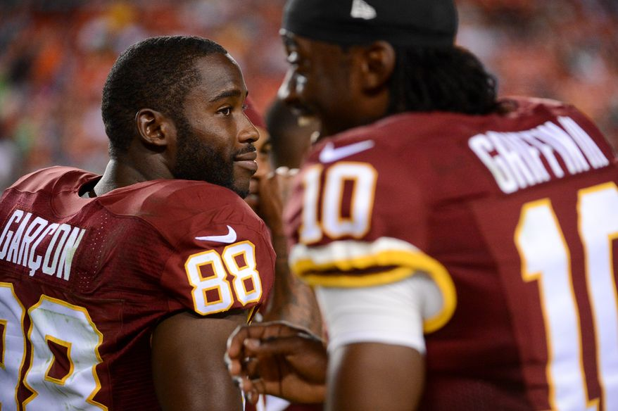 Washington Redskins wide receiver Pierre Garcon (88) and Washington Redskins quarterback Robert Griffin III (10) on the sideline as the Washington Redskins play the Cleveland Browns in NFL preseason football at FedExField, Landover, Md., Monday, August 18, 2014. (Andrew Harnik/The Washington Times)