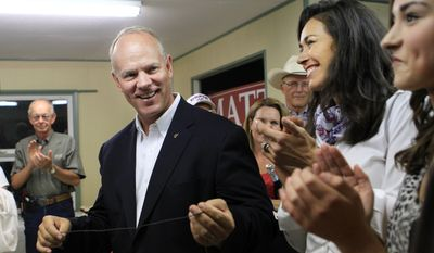 Wyoming Governor Matt Mead smiles as family and friends applaud his primary election win over challengers Taylor Haynes and Cindy Hill during a primary election party Tuesday evening, Aug. 19, 2014, in Cheyenne, Wyo.  (AP Photo/The Wyoming Tribune Eagle, Blaine McCartney)