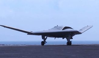 The Navy's unmanned X-47B lands aboard USS Theodore Roosevelt (CVN 71) Aug. 17. (U.S. Navy)