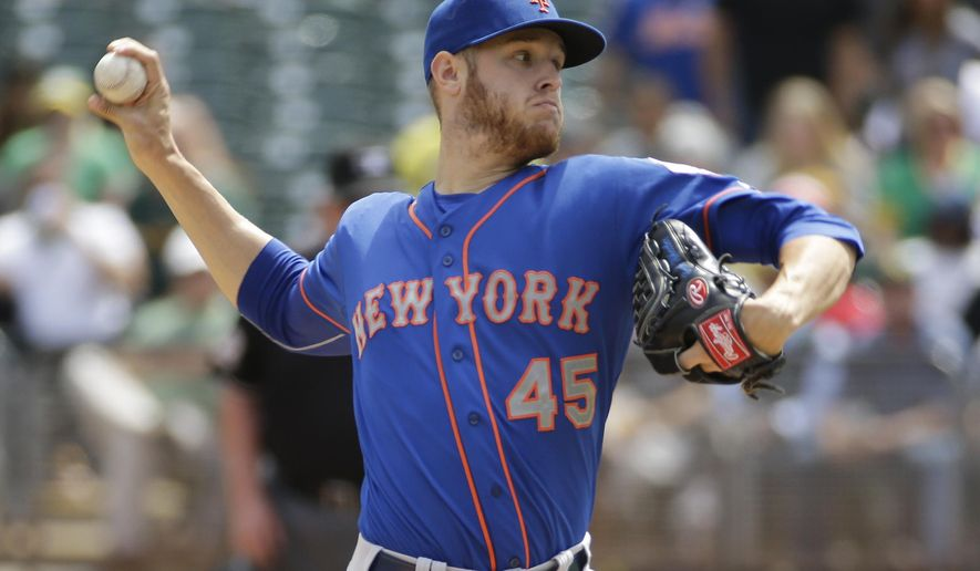 New York Mets starting pitcher Zack Wheeler throws in the first inning of their interleague baseball game against the Oakland Athletics Wednesday, Aug. 20, 2014, in Oakland, Calif. (AP Photo/Eric Risberg)