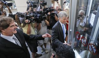 Former Virginia Gov. Bob McDonnell, right, arrives at federal court with his attorney, Henry Asbill, left, Wednesday, Aug. 20, 2014, in Richmond, Va.  The defense continues to present its case in McDonnell's corruption case.  (AP Photo/Steve Helber)