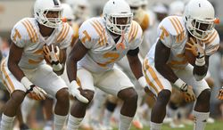 In this photo taken on Saturday, Aug. 16, 2014, Tennessee wide receivers Josh Malone, left, Drae Bowles, and Pig Howard warm up during NCAA college football practice in Knoxville, Tenn. (AP Photo/The Knoxville News Sentinel, Adam Lau)