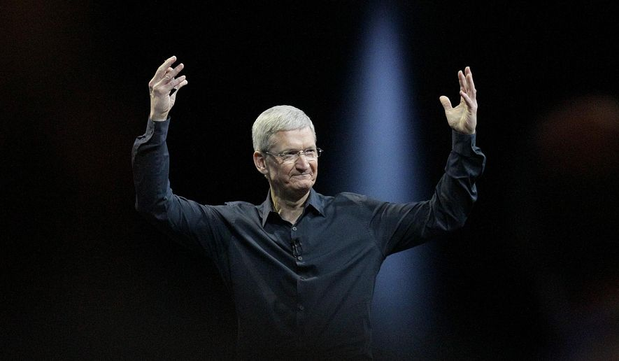 FILE - In this June 2, 2014 file photo, Apple CEO Tim Cook gestures during the Apple Worldwide Developers Conference in San Francisco. Apple's stock touched a new high Wednesday, Aug. 20, 2014, reflecting investors' renewed faith in Cook's ability to outwit the competition and expand the technological hit factory built by the late Steve Jobs. (AP Photo/Jeff Chiu, File)