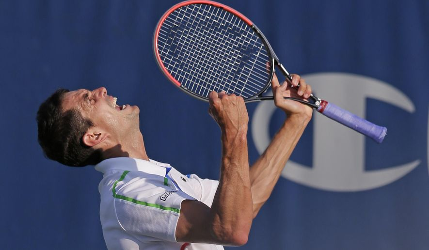 Guillermo Garcia-Lopez, of Spain, reacts after defeating Donald Young 6-7 (4), 6-3, 7-6 (6) in a match at the Winston-Salem Open tennis tournament in Winston-Salem, N.C., Wednesday, Aug. 20, 2014. (AP Photo/Chuck Burton)