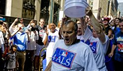 Major League Baseball Executive Vice President of Baseball Operations Joe Torre participates in the ALS Ice-Bucket Challenge outside the organization's headquarters in New York, Wednesday, Aug. 20, 2014. Torre participated with more than 160 other MLB employees to raise more than $16,000 for the ALS Association. (AP Photo/Vanessa A. Alvarez)