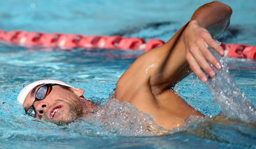 U.S. swimmer Michael Phelps trains ahead of the Pan Pacific swimming championships in Gold Coast, Australia, Wednesday, Aug. 20, 2014. (AP Photo/Rick Rycroft)