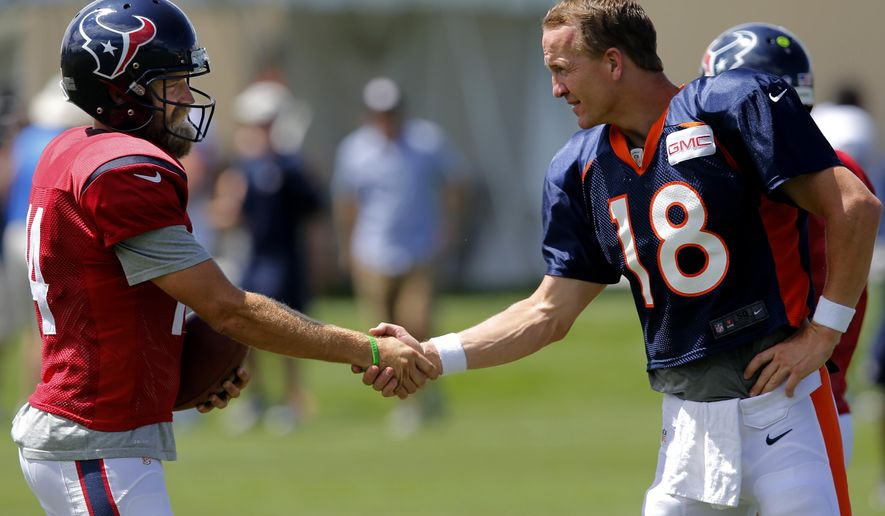 Houston Texans quarterback Ryan Fitzpatrick (14) and Denver Broncos quarterback Peyton Manning (18) shake hands following a joint practice between the Denver Broncos and the Houston Texans on Wednesday, Aug. 20, 2014, in Englewood, Colo. (AP Photo/Jack Dempsey)