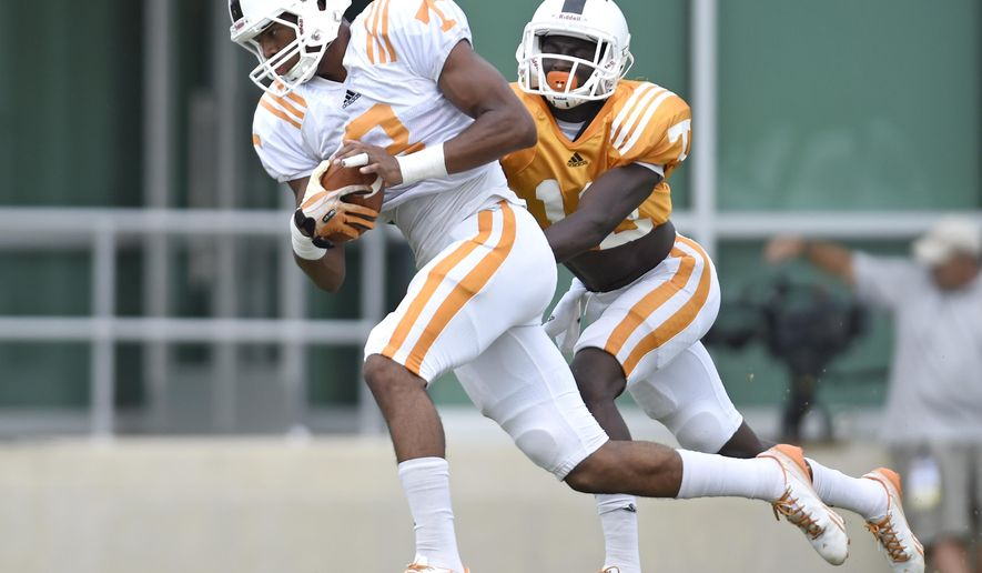 In this photo taken on Friday, Aug. 8, 2014, Tennessee wide receiver Josh Malone, left, is trailed defensive back Emmanuel Moseley during NCAA college football practice  in Knoxville, Tenn. (AP Photo/The Knoxville News Sentinel, Adam Lau)