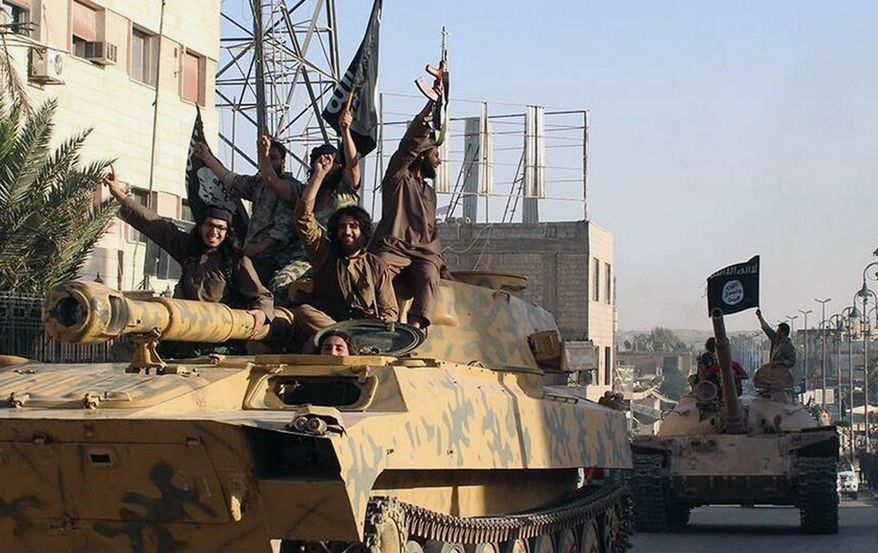 """The Islamic State, which controls large portions of Iraq and Syria, """"seems to be absolutely certain they will be trying to kill as many Americans as possible in the United States as well as elsewhere,"""" said Robert Spencer, director of Jihad Watch. (Raqqa Media Center Via Associated Press)"""