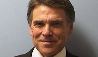 Texas Gov. Rick Perry was booked at the Blackwell-Thurman Criminal Justice Center in Austin, Texas, for two felony indictments of abuse of power on Tuesday. (Austin Police Department via Associated Press)