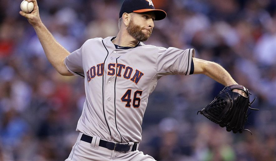 Houston Astros' Scott Feldman delivers a pitch during the first inning of a baseball game against the New York Yankees Wednesday, Aug. 20, 2014, in New York. (AP Photo/Frank Franklin II)