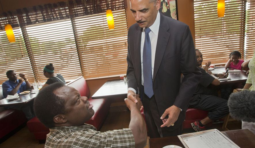 Attorney General Eric Holder stops to shake hands with a patron at Drake's Place Restaurant, before his meeting with local community leaders, Wednesday, Aug. 20, 2014 in Ferguson, Mo. Holder arrived in Missouri on Wednesday, a small group of protesters gathered outside the building where a grand jury could begin hearing evidence to determine whether a Ferguson police officer who shot 18-year-old Michael Brown should be charged in his death.   (AP Photo/Pablo Martinez Monsivais, Pool)