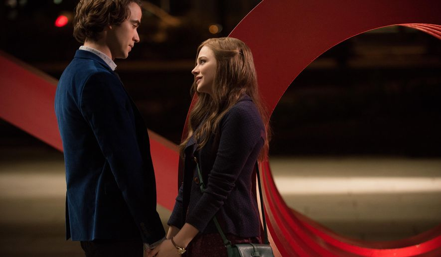 "This image released by Warner Bros. Pictures shows Jamie Blackley, left, and Chloe Grace Moretz in a scene from ""If I Stay."" (AP Photo/Warner Bros. Pictures, Doane Gregory)"