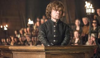 "This image released by HBO shows Peter Dinklage in a scene from ""Game of Thrones.""  (AP Photo/HBO, Helen Sloan)"