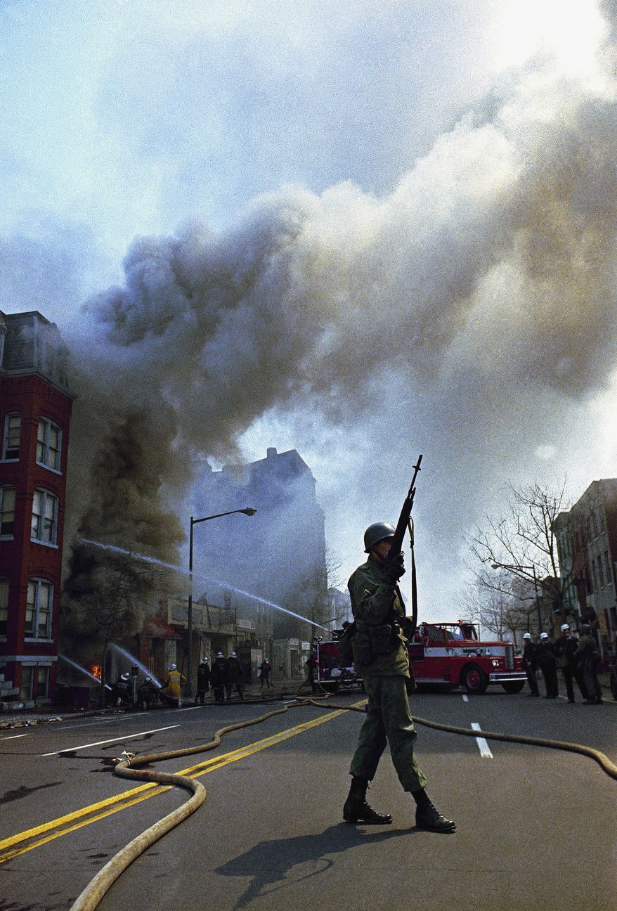 Firemen and National Guardsmen were called out to quell rioting that broke out in Washington following the news of the assassination of Dr. Martin Luther King, Jr., April 6, 1968.  (AP Photo)