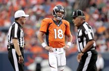 Denver Broncos quarterback Peyton Manning (18) reacts to a call during the first half of an NFL preseason football game against the Seattle Seahawks, Thursday, Aug. 7, 2014, in Denver. (AP Photo/Joe Mahoney)