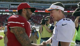 San Francisco 49ers quarterback Colin Kaepernick, left, shakes hands with Denver Broncos quarterback Peyton Manning after an NFL preseason football game in Santa Clara, Calif., Sunday, Aug. 17, 2014. The Broncos won 34-0. (AP Photo/Marcio Jose Sanchez)