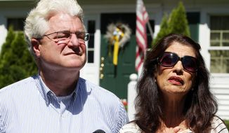 Diane and John Foley talk to reporters after speaking with U.S. President Barack Obama Wednesday, Aug. 20, 2014 outside their home in Rochester, N.H. Their son, James Foley was abducted in November 2012 while covering the Syrian conflict. Islamic militants posted a video showing his murder on Tuesday and said they killed him because the U.S. had launched airstrikes in northern Iraq. (AP Photo/Jim Cole)