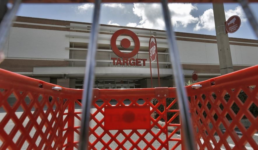 This Monday, Aug. 19, 2013, file photo shows a shopping cart outside a Target store in Riverview, Fla. (AP Photo/Chris O'Meara, File)