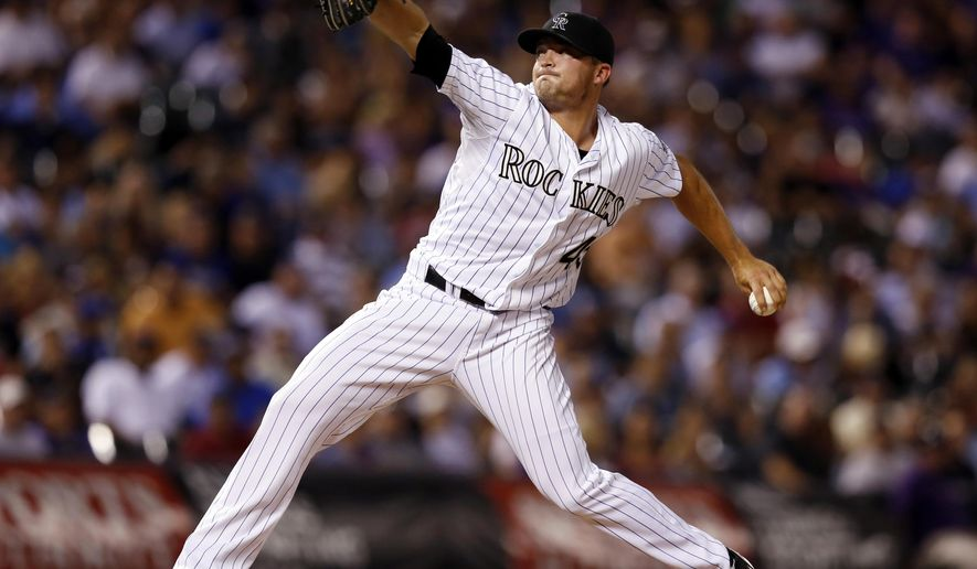 Colorado Rockies relief pitcher Rex Brothers throws against the Kansas City Royals during the eighth inning of a baseball game Tuesday, Aug. 19, 2014, in Denver. (AP Photo/Jack Dempsey)
