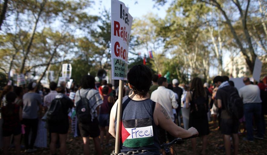Demonstrators gather in Brooklyn's Cadman Plaza Park as they prepare to march across the Brooklyn Bridge during a pro-Palestinian rally, Wednesday, Aug. 20, 2014, in New York. (AP Photo/Jason DeCrow)