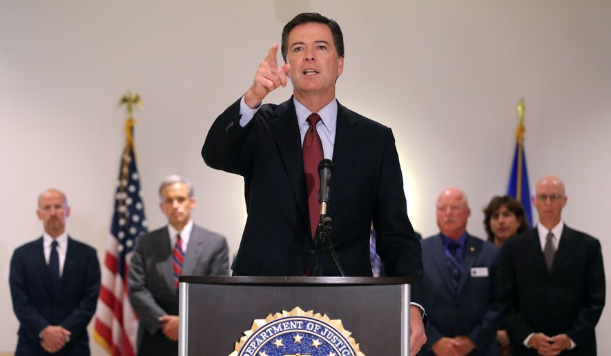 "FBI Director James Comey takes a question during a news conference at the FBI field office in Denver, Wednesday Aug. 20, 2014. FBI Director James Comey says Islamic State extremists who executed journalist James Foley are ""savages"" and that the agency is helping investigate the killing.  (AP Photo/Brennan Linsley)"