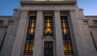 "FILE - This Sept. 18, 2013 file photo shows the Federal Reserve headquarters in Washington. Minutes of the Fed's discussion at its July 29-30, 2014 meeting show that some officials thought the economy was improving enough that the Fed would need ""to call for a relatively prompt move"" toward reducing the support it has been providing. Otherwise, they felt the Fed risked overshooting its targets for unemployment and inflation. (AP Photo/J. David Ake, File)"