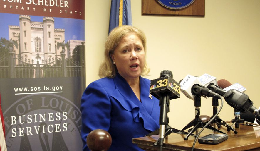U.S. Sen. Mary Landrieu, a Democrat, talks to reporters after signing her qualifying paperwork to run for re-election on Wednesday, Aug. 20, 2014, in Baton Rouge, La. Landrieu is seeking a fourth term. (AP Photo/Melinda Deslatte)