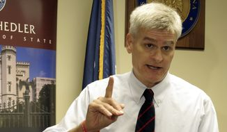 U.S. Rep. Bill Cassidy, a Republican, speaks to reporters after qualifying to run for the U.S. Senate, Wednesday, Aug. 20, 2014, in Baton Rouge, La. Cassidy is seeking to keep Democratic Sen. Mary Landrieu from a fourth term in office. (AP Photo/Melinda Deslatte) ** FILE **