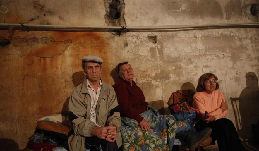 Local residents sit in a basement which is being used as a shelter after shelling in Donetsk, eastern Ukraine, Wednesday, Aug. 20, 2014. After days of street battles and weeks of shelling, Ukrainian troops made a significant push Wednesday into rebel-held territory, claiming control over a large part of the separatist stronghold of Luhansk and nearly encircling Donetsk, the largest rebel-held city. (AP Photo/Max Vetrov)