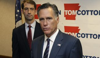 Former Republican presidential candidate Mitt Romney, right, speaks at a North Little Rock, Ark., news conference as he endorses U.S. Rep. Tom Cotton, R-Ark., in the race for U.S. Senate, Thursday, Aug. 21, 2014. (AP Photo/Danny Johnston)