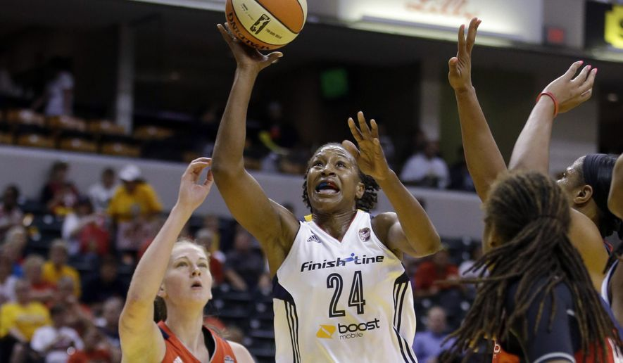 Indiana Fever's Tamika Catchings puts up a shot against Washington Mystics' Emma Meesseman during the first half of Game 1 of a WNBA basketball Eastern Conference semifinal, Thursday, Aug. 21, 2014, in Indianapolis. (AP Photo/Darron Cummings)