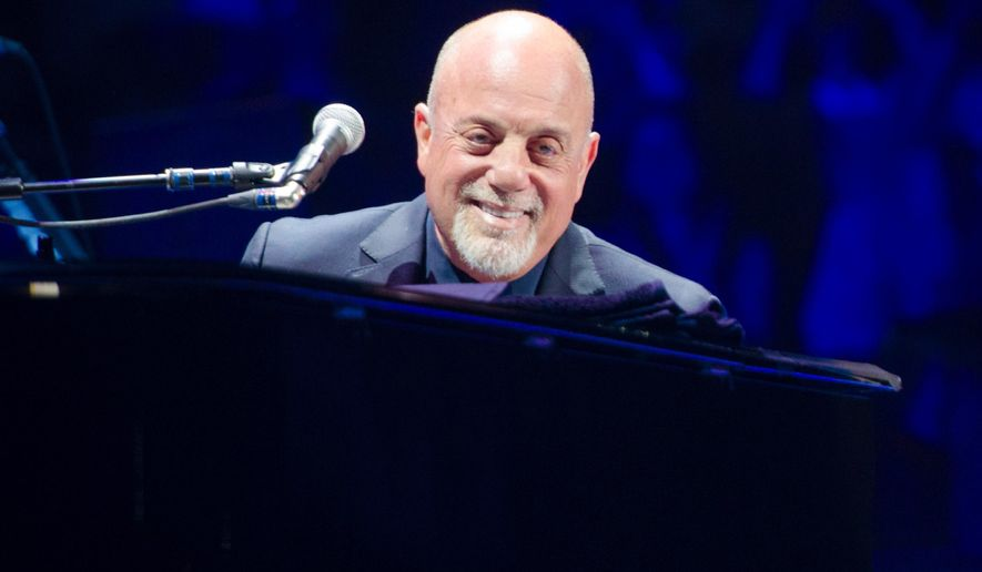FILE - In this May 9, 2014 file photo, Billy Joel performs at Madison Square Garden in New York. Joel, Stevie Wonder and Garth Brooks are among a list of performers set to receive ASCAP Centennial Awards. The American Society of Composers, Authors and Publishers announced Thursday that Joan Baez and Stephen Sondheim will also receive the top honor Nov. 17 at the Waldorf Astoria gala in New York. (Photo by Scott Roth/Invision/AP, File)