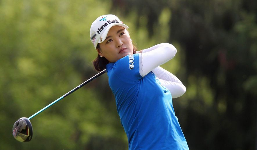So Yeon Ryu, of South Korea, watches her tee shot on the 14th hole at the Canadian Pacific Women's Open golf tournament in London, Ontario, Thursday, Aug. 21, 2014. (AP Photo/The Canadian Press, Dave Chidley)