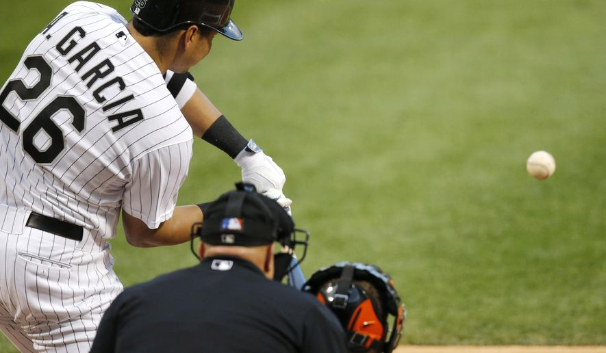 Chicago White Sox's Avisail Garcia hits a two-run home run off Baltimore Orioles starting pitcher Wei-Yin Chen  during the first inning of a baseball game Wednesday, Aug. 20, 2014, in Chicago. (AP Photo/Charles Rex Arbogast)