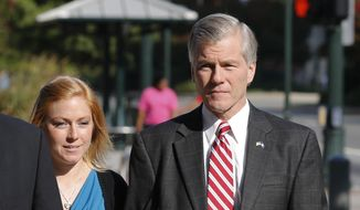 Former Virginia Gov. Bob McDonnell arrives at federal court with his daughter Cailin Young, in Richmond, Va., Thursday, Aug. 21, 2014. McDonnell begins the second day of testimony in his own defense on corruption charges. (AP Photo/Steve Helber)