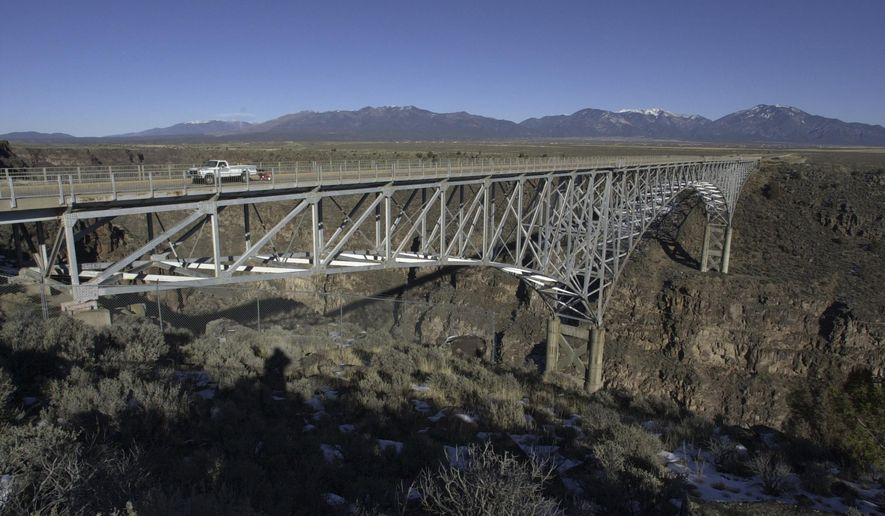 FILE - This Dec. 9, 2006 file photo, shows the Rio Grande Gorge Bridge near Taos N.M. The state's Department of Transportation announced Wednesday, Aug. 20, 2014 that officials are designing a plan to install ten telephones around the bridge. Officials said the phones will be answered by the New Mexico Crisis Access Hotline and crisis counselors who will try to negotiate with those attempting to jump off the bridge. (AP Photo/Mike Stewart, File)