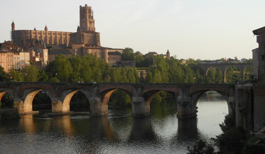 The 13th-century Gothic cathedral of Ste. Cecile towers over the Tarn river in the beautiful town of Albi in southwestern France. (Corrina Lothar/Special to The Washington Time)