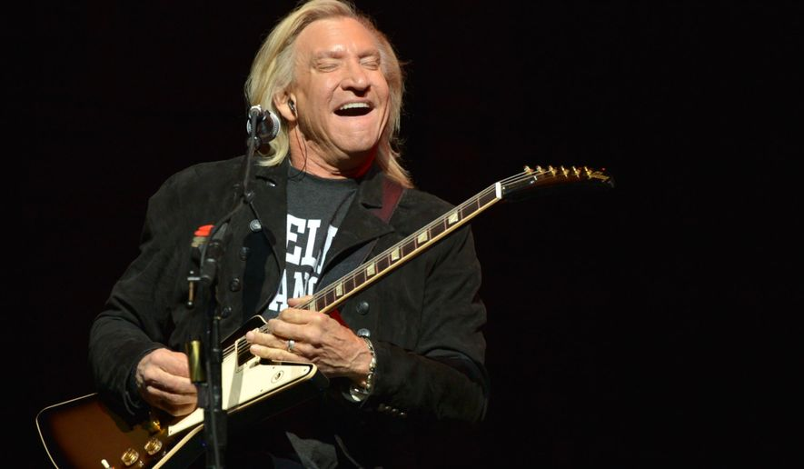 """Joe Walsh of The Eagles performs on the """"History of the Eagles"""" tour at the Forum in Los Angeles on Jan. 15, 2014. (John Shearer/Invision/Associated Press)"""