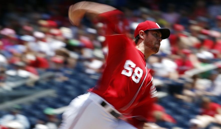 In this image taken with a slow shutter speed, Washington Nationals starting pitcher Doug Fister (58) throws during the third inning of a baseball game against the Texas Rangers at Nationals Park Saturday, May 31, 2014, in Washington. (AP Photo/Alex Brandon)