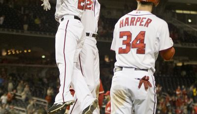 Washington Nationals Jayson Werth (28) celebrate scoring the wining run with teammates Ian Desmond (20) and Bryce Harper (34) on a single hit by Adam LaRoche during the ninth inning of a baseball game against the Los Angeles Angels, Wednesday, April 23, 2014 in Washington. Nationals won 5-4. (AP Photo/Pablo Martinez Monsivais)