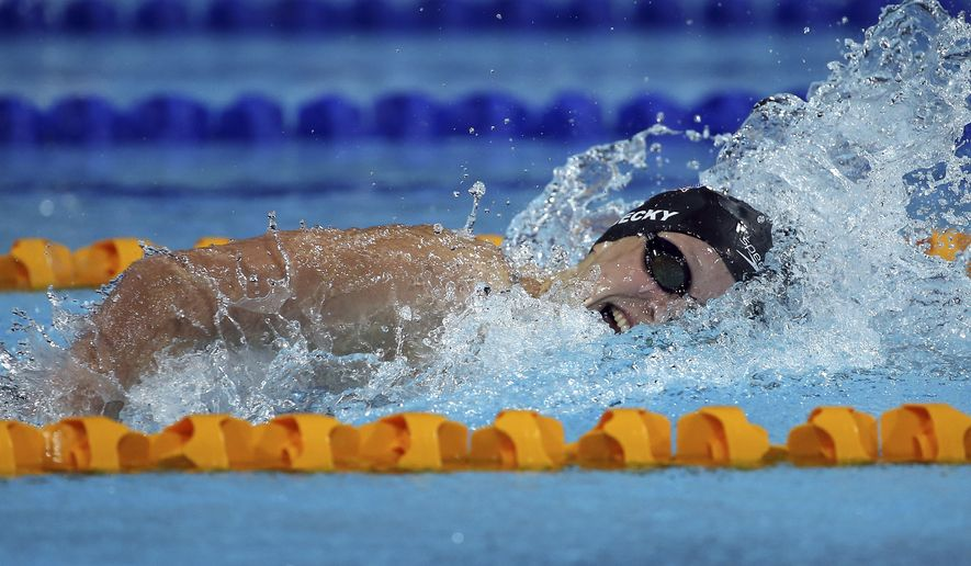 Katie Ledecky of the U.S. swims during her women's 200m freestyle at the Pan Pacific swimming championships in Gold Coast, Australia, Thursday, Aug. 21, 2014. (AP Photo/Rick Rycroft)