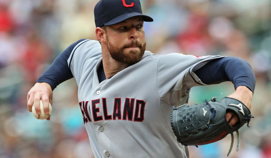 Cleveland Indians pitcher Corey Kluber throws against the Minnesota Twins in the first inning of a baseball game, Thursday, Aug. 21, 2014, in Minneapolis. (AP Photo/Jim Mone)