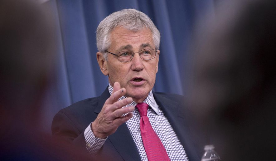 FILE - This July 3, 2014 file photo shows Defense Secretary Chuck Hagel speaking at the Pentagon. Hagel said Thursday that US airstrikes have helped Iraqi and Kurdish forces regain their footing in Iraq, but he expects Islamic State militants will regroup and stage a new offensive.  (AP Photo/Pablo Martinez Monsivais, File)